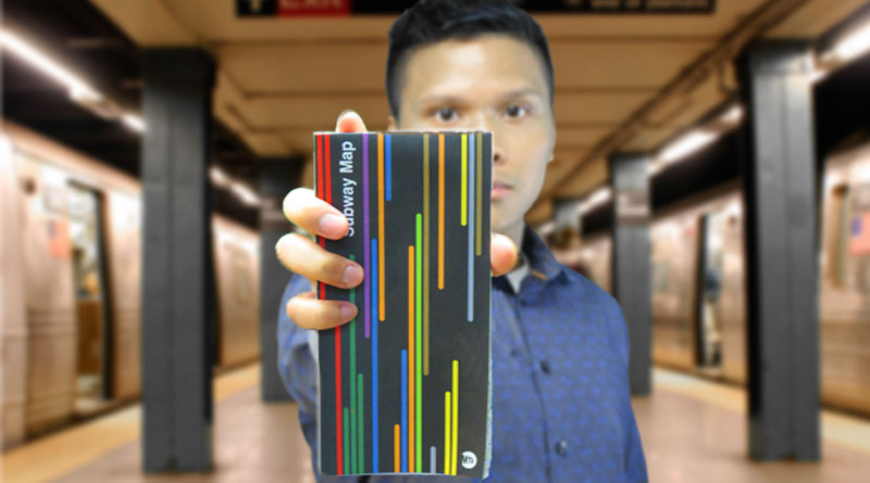 man holding nyc subway map