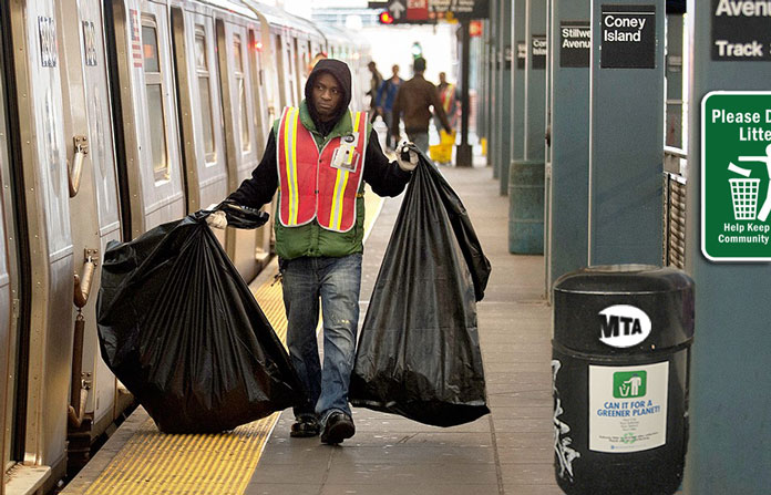 man cleaning ny subway